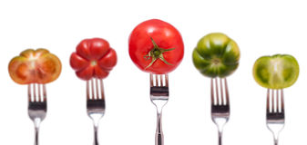 Five tomatoes on a fork Stock Photo
