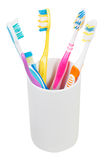 Five tooth brushes in ceramic glass Royalty Free Stock Image