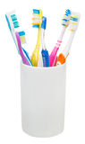 Five tooth brushes and interdental brush Royalty Free Stock Image
