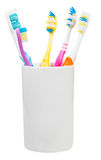 Five toothbrushes in ceramic glass Stock Photos