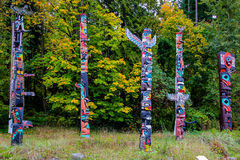 Five Totem Poles. Five of the hand carved totem poles in Stanley Park, Vancouver, BC Stock Photos