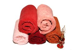 Five Towels. Colorful towels and perfume bottle on white background Stock Photos