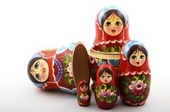 Five traditional Russian matryoshka dolls. On white background Stock Photos