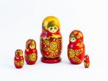 Five traditional Russian matryoshka dolls on white background. Set of five traditional Russian matryoshka dolls on white background Stock Image
