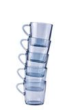 Five transparent dark blue mugs Stock Images