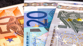 Five, Twenty and Fifty Euro bills on black background Royalty Free Stock Images