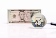 Five U.S. dollars magnified Stock Photography