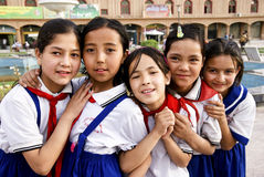 Five uighur girl students. Looks at the camera ,taking in front of a school in Xinjiang Province in China,May 25th,2011 Royalty Free Stock Image