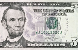 Five US dollar banknote closeup. Portrait of the US President Abraham Lincoln on five dollar banknote bill, front side obverse royalty free stock photography