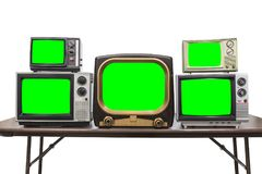 Five Vintage Televisions Isolated with Chroma Green Screens and. Five vintage televisions isolated on white with chroma green screens and clipping path Royalty Free Stock Photos