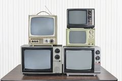 Free Five Vintage Televisions Stacked On Table Stock Images - 137682254