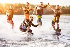 Five wake bord riders having fun Stock Images