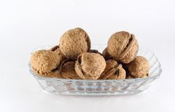 Five walnut all together on a plate Royalty Free Stock Photos