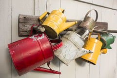 Five Watering Cans Stock Images