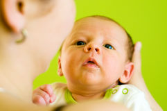 Five week baby. After breast feeding. Baby is looking straight at camera stock image