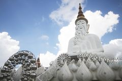 Five white buddha statues sitting well alignment in front of blue sky and decorating wonderful attractive mirror. One of the most interesting landmark in north stock photos
