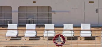 Five White Chairs on Deck Royalty Free Stock Photos