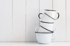 Five white enameled mugs Stock Photo