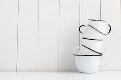 Five white enameled mugs Stock Images