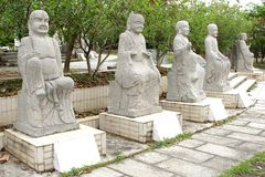 Five white marble Buddha statues in a garden, China Stock Photography