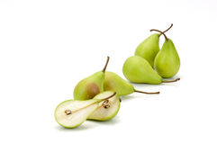 Five whole green pears and one halved Royalty Free Stock Photo