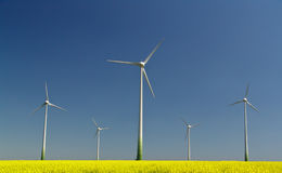 Five wind power stations. On a field Stock Images