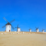 Five windmills. Castile La Mancha, Spain. Five windmills near Alcazar de San Juan, Castile - La Mancha. Castile - La Mancha region, Spain, is famous due to its Royalty Free Stock Photography