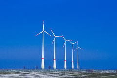 Five windmills ia a group in winter landscape Royalty Free Stock Photography