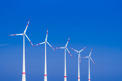 Five windmills ia a row Royalty Free Stock Photos