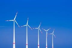 Five windmills ia a row Royalty Free Stock Photos