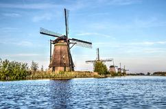Five windmills in a row royalty free stock photos