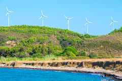 Five windmills by the sea Royalty Free Stock Photo