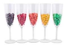 Five wine glasses with a color dragee Stock Photo