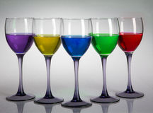 Five wine glasses with colours Royalty Free Stock Photography