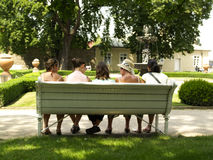 Five women on the bench. Sunny day in the park. Five women on the bench Royalty Free Stock Photos