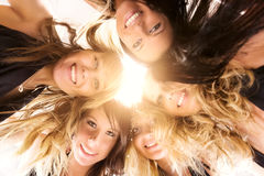 Five women team. Bright sunlight from above Stock Photo