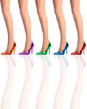 Five womens legs standing in high heel shoes Stock Photo