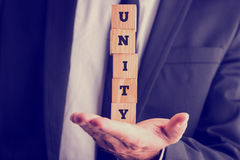 Five wooden cubes spelling the wor Unity Royalty Free Stock Photography
