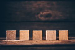 Wooden Cubes on Wood Background royalty free stock photos