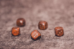 Five wooden dices on brown velvet background Stock Photo