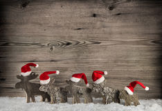 Five wooden handmade reindeer on a background with place for tex Stock Photos