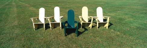 Five wooden lawn chairs Stock Photo