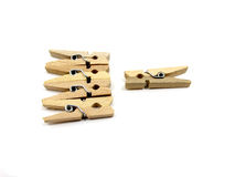 Five wooden pins with one is separated Stock Photos