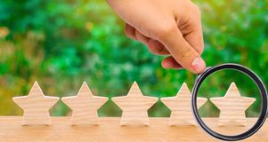 Five wooden stars. Get the fifth star. The concept of the rating. Of hotels and restaurants, the evaluation of critics and visitors. Quality level, good service royalty free stock photo