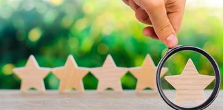 Five wooden stars. Get the fifth star. The concept of the rating. Of hotels and restaurants, the evaluation of critics and visitors. Quality level, good service stock photos