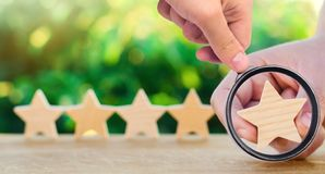 Five wooden stars. Get the fifth star. The concept of the rating. Of hotels and restaurants, the evaluation of critics and visitors. Quality level, good service stock photography