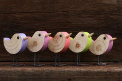 Five Wooden Toy Birds Decoration Rough Background Royalty Free Stock Image