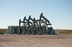 Five pumpjack in a row stock images