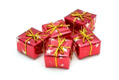 Five wrapped gifts. With golden bows, over a white background royalty free stock images