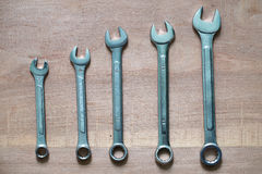Five wrenches on the table Stock Photos